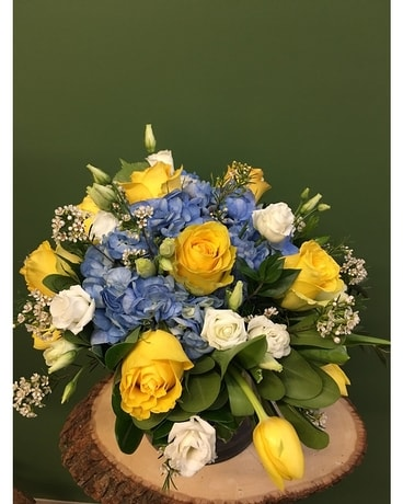 Cube of Blue White and Yellow Flower Arrangement