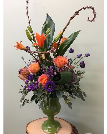 Vase of Orange and Purple Flower Arrangement
