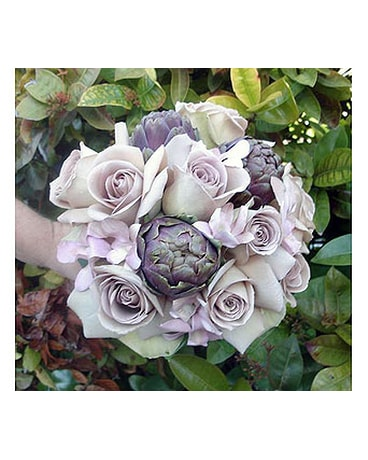 Lavender roses, orchids and artichokes bouquet