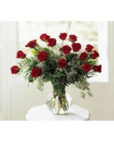18 Roses Professionally Arranged in a vase