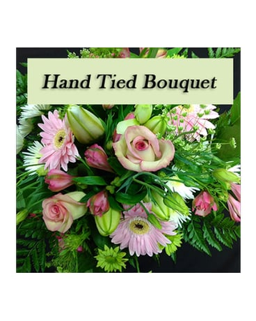 Hand tied bouquet in pink tones