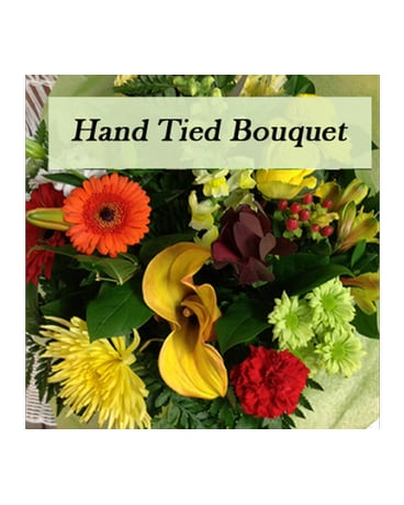 Hand tied bouquet in Warm tones