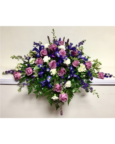 Shades of Purple with White Casket Spray