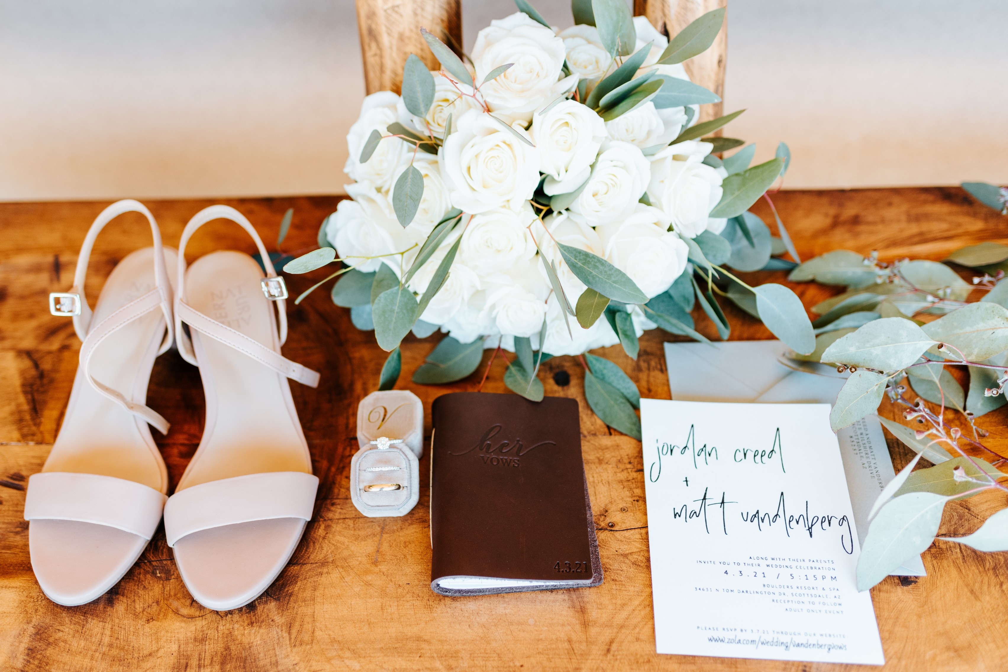 Shoes and miscellaneous idecor on table with a bouquet