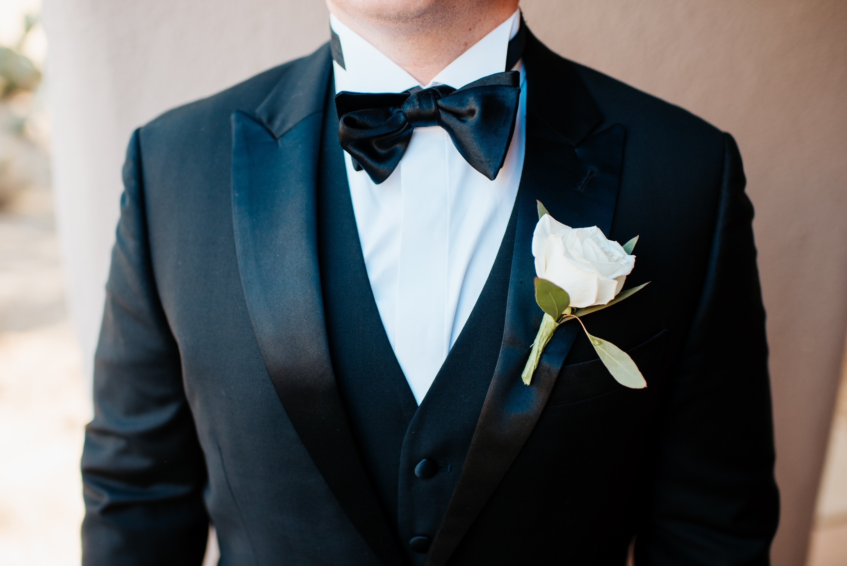 Gorgeous white flower tucked in suit pocket