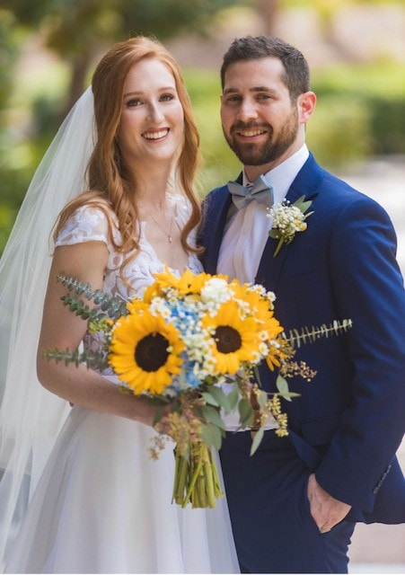 Couple with sunflower bouquet