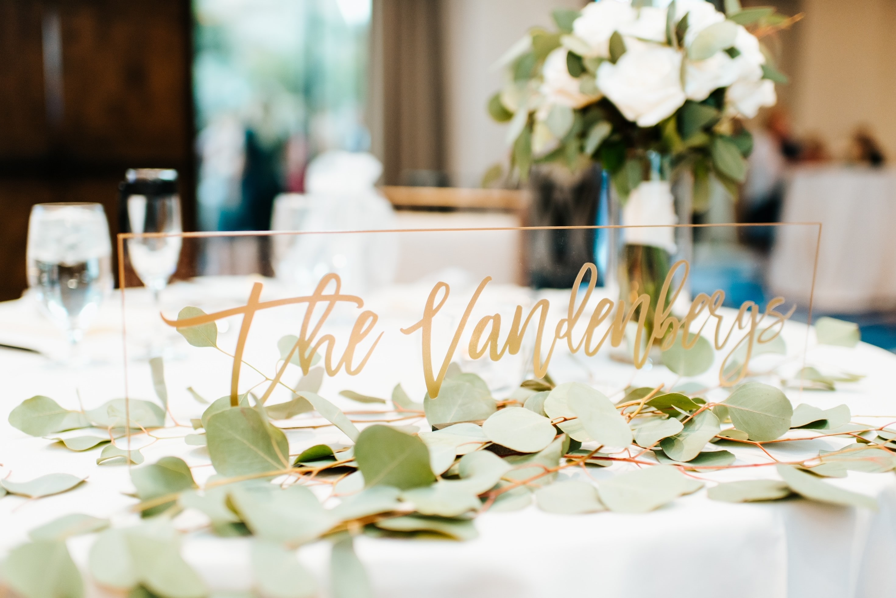 white bouquet and petals as centerpiece and table decor