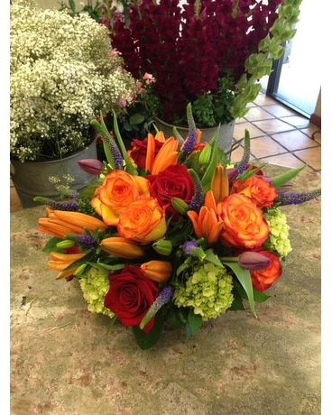 Orange with purple tails Flower Arrangement