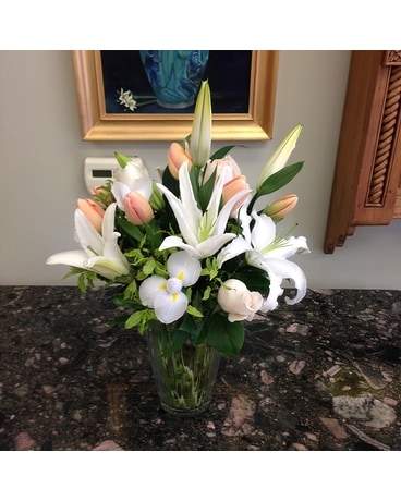 Peach tulips with white stargazers