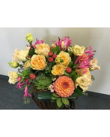 Compact Arrangement of Yellow and Pink Flower Arrangement