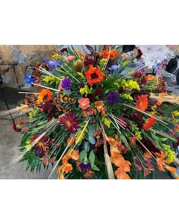Colorful Reflections Funeral Casket Spray Flowers