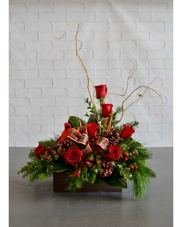 a mountain christmas flower arrangement