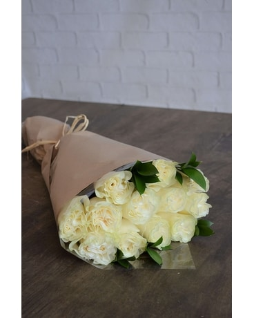 Wrapped roses in white jennies flowers wrapped roses in white flower arrangement mightylinksfo