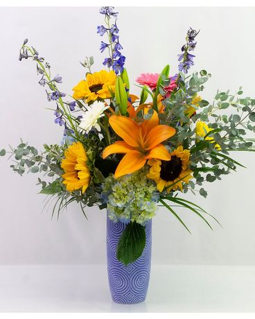 Vibrant Blue Vase Flower Arrangement