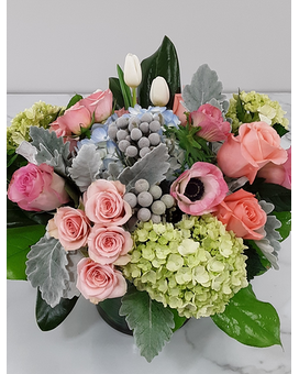 Bright Arrival Flower Arrangement