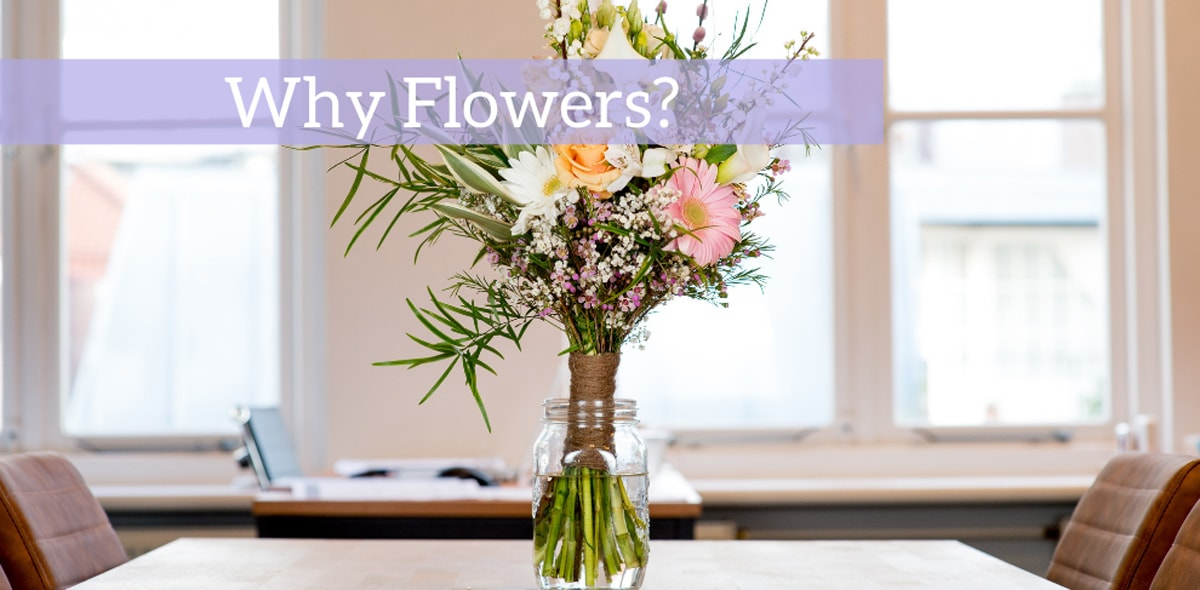 Why Flowers? Table with flower arrangement