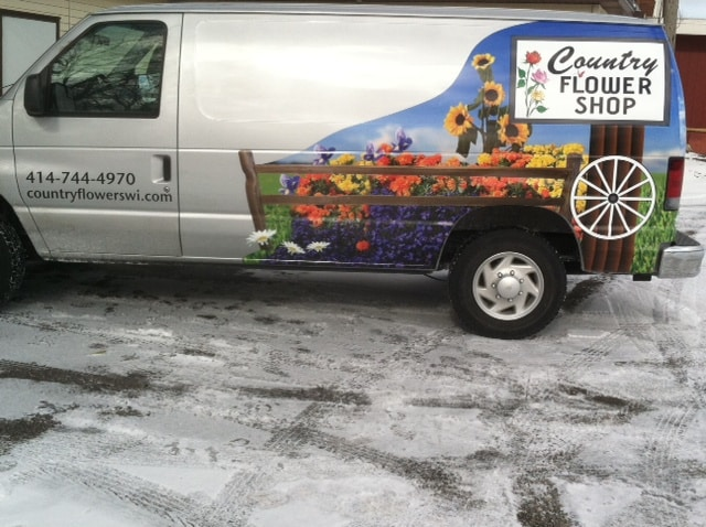 Delivering happiness throughout the Milwaukee metro with our busy Country Flower Shop delivery van.