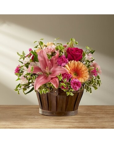 The FTD® Spring Garden® Basket- BASKET INCLUDED Flower Arrangement