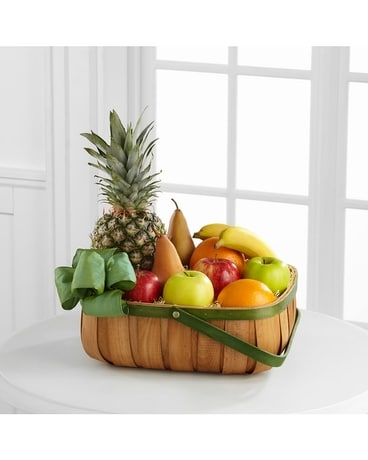 The FTD® Thoughtful Gesture™ Fruit Basket Flower Arrangement