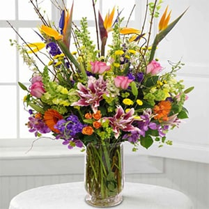 Flower arrangement designed with an assortment of the season's highest quality premium floral varieties