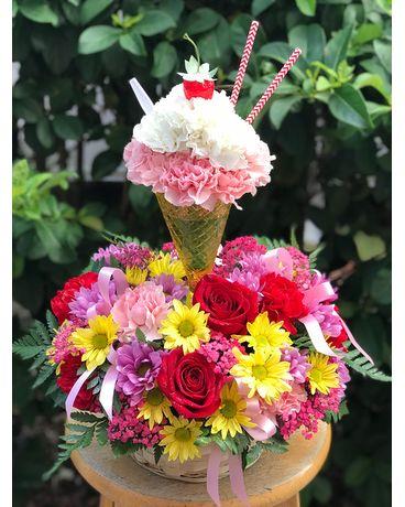 Spring hill florist flower delivery by sherwood florist plus nursery sherwoods cupcake birthday centerpiece flower arrangement mightylinksfo