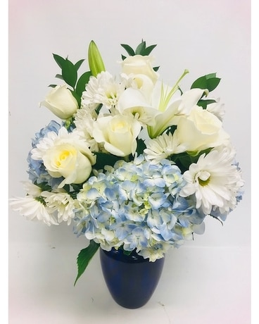 Shining Light in Blue Flower Arrangement