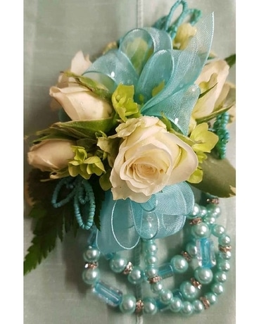 White Roses and Blue Corsage Flower Arrangement