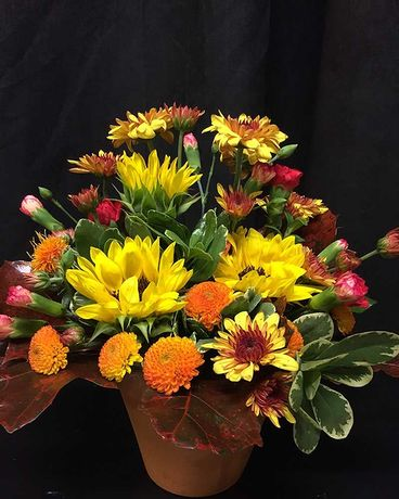 Fall Centrepiece with mini sunflowers Flower Arrangement