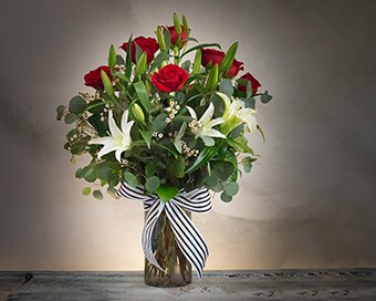 Shirley's Dozen Roses with White Lilies