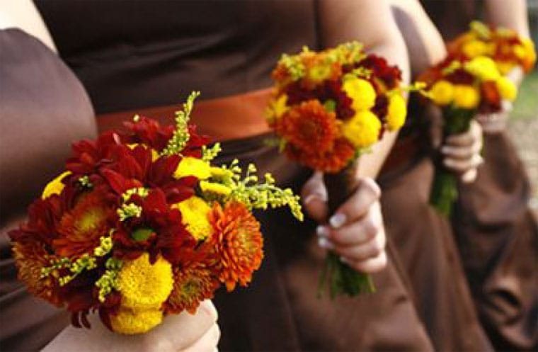 Bridesmaids with Red, Orange and Yellow Bridesmaids Bouquets
