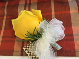 Small yellow rose corsage