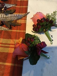 salmon-colored rose boutonnieres