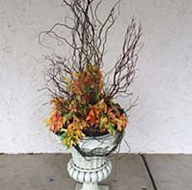 Rustic fall urn dried flower arrangement
