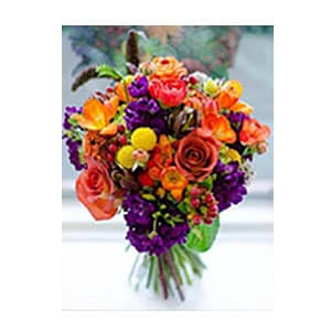 orange and purple vased arrangement