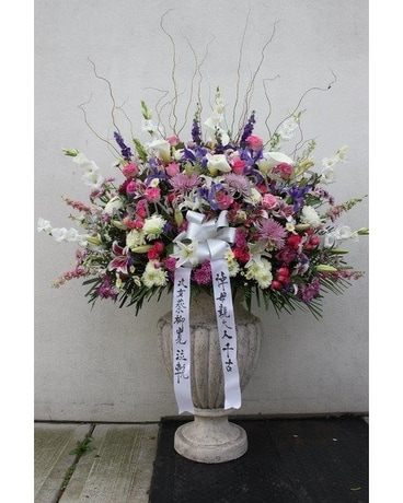 Exotic Pink Purple Lavender And White Basket Flower Arrangement