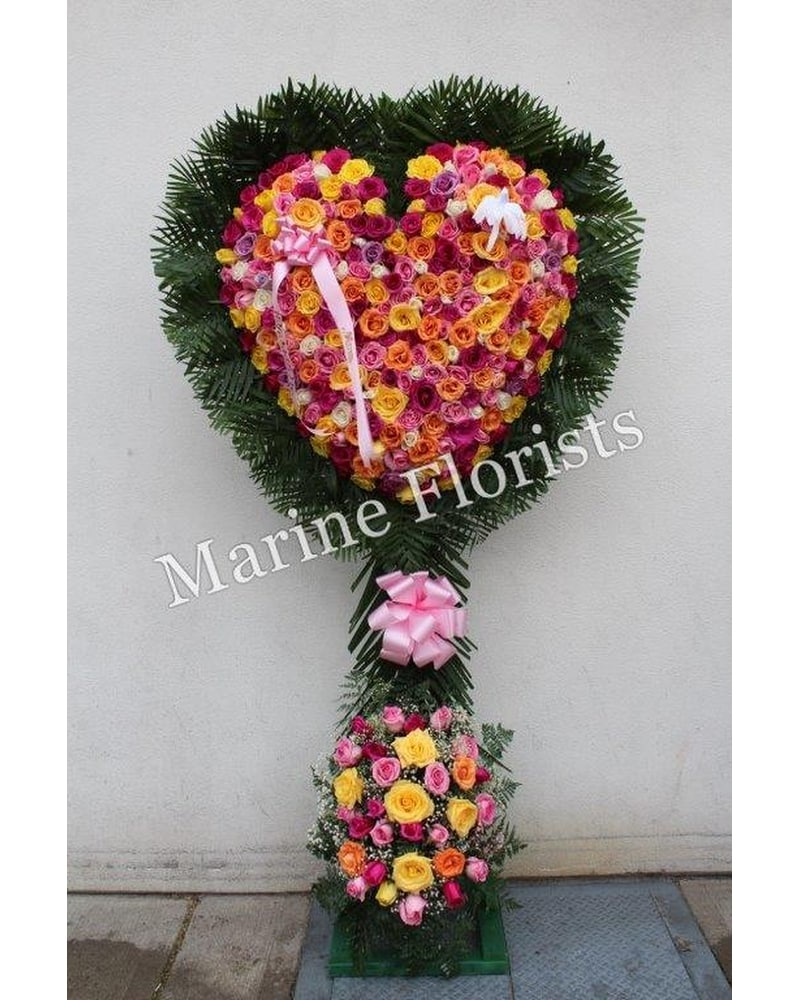 Sympathy buying guide i marine florists i 1995 flatbush ave casket sprays inside casket flowers hearts crosses izmirmasajfo