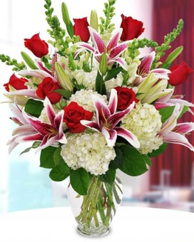 Stargazers, Roses, Hydrangea and Complimentary Fil Flower Arrangement