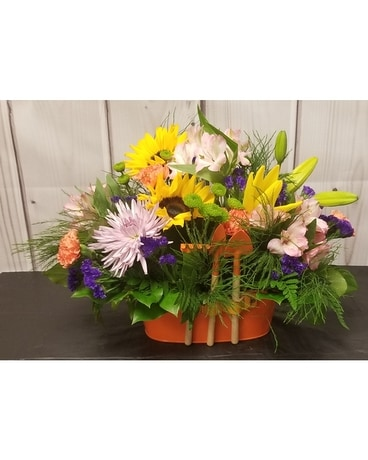 Planter with Tools Flower Arrangement
