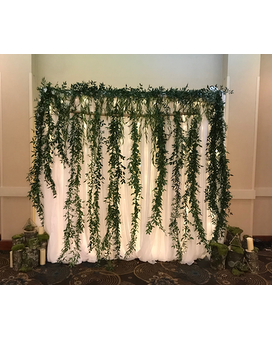 Greenery Backdrop Flower Arrangement
