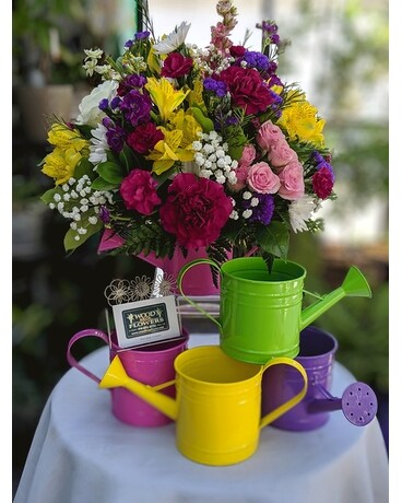 Colored Metal Watering Can Flower Arrangement