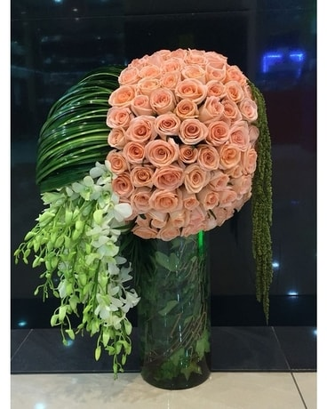 Round Up Some Peachy Roses & Orchids Flower Arrangement