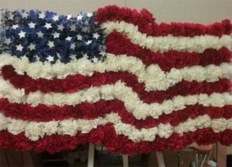 American flag tribute made of flowers