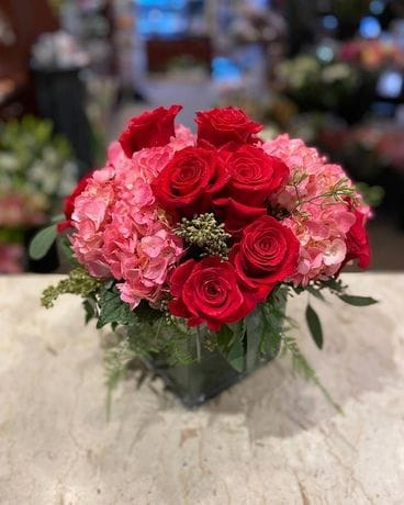 Princess with Red Roses Flower Arrangement