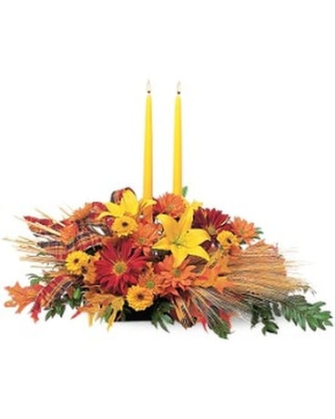 Centerpiece with Tapers Flower Arrangement