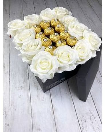 12 white roses with 12 Ferrero Rocher chocolates Flower Arrangement