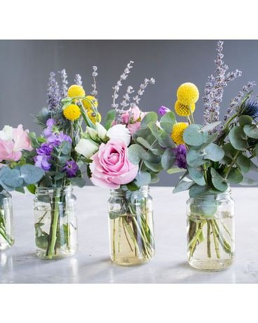 Mixed flowers In Mason Jar Flower Arrangement