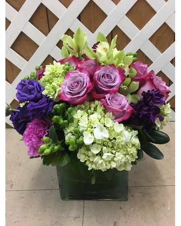Roses, Orchids & Hydrangea in a leaf lined vase Custom product