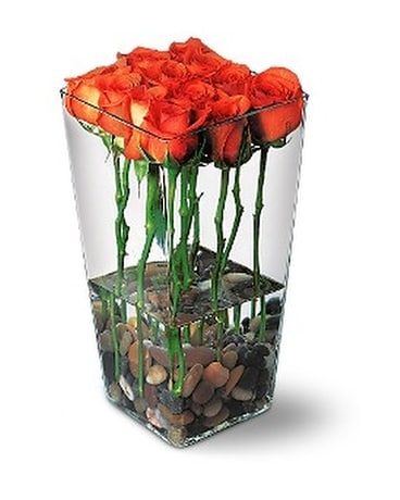Orange Roses With River Rocks Flower Arrangement