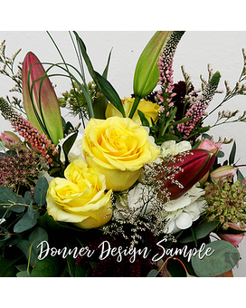 Seasonal Surprise Flower Arrangement