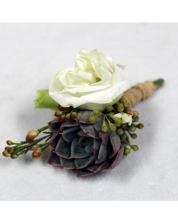 Organic with a twist Boutonniere Flower Arrangement